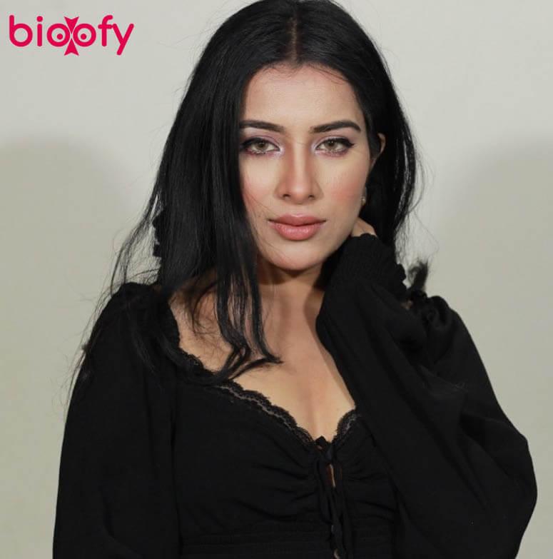 Sara Gurpal black dress